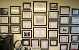 Is it pretentious to hang framed licenses, certificates, and/or degrees in your office?