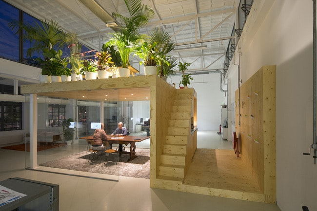 A Central Glass Meeting Room, With A Pantry And Stairs Leading To The  Plant Filled Roof Organizes The Large Warehouse Space In A Single Sweeping  Gesture, ...