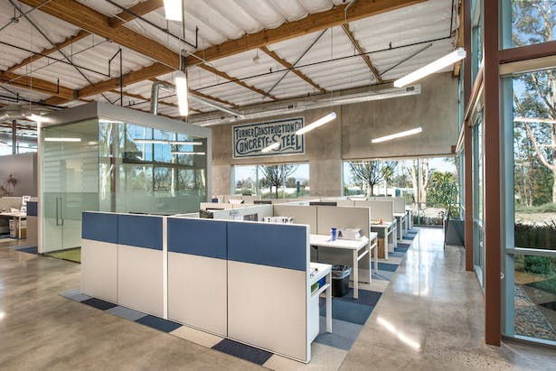 The beauty of raw materials and articulated systems shine brightly in this scheme as they add a layer of transparency to the open office.