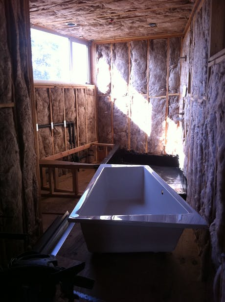 Setting and trapezoidal shaped tub into a trapezoidal shaped room, in Manhattan Beach.