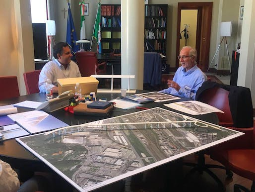 The photo shows Renzo Piano discussing designs for a replacement bridge with the governor of the Liguria region, Giovanni Toti. Image via Toti's Facebook page.