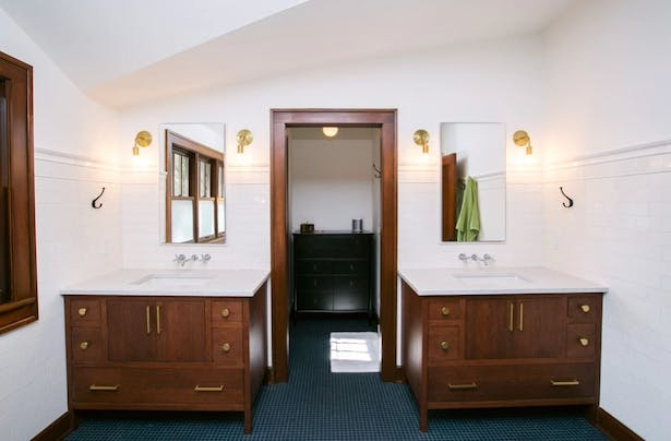 Master Bath built under the eaves of the low-slung clipped gables.