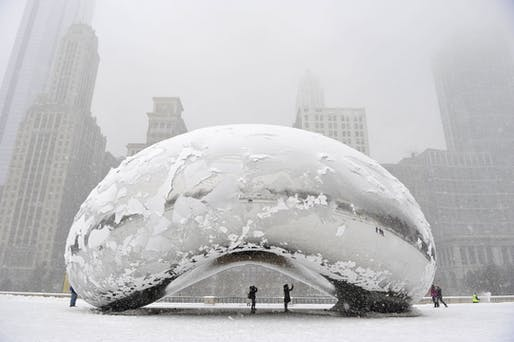 "In response to extreme temperatures in Chicago, the sculpture ""Cloud Gate,"" aka ""the bean"" by Anish Kapoor is covered in snow. (Photo: Brian Kersey/Getty Images)"