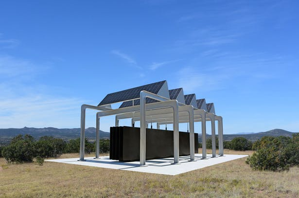 The Big Black Battery Pavilion that makes electricity from the sun for the local community.