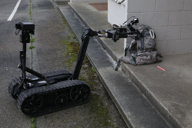 A US Navy Mark II Talon explosive ordnance disposal (EOD) robot inspects a simulated suspicious package during an anti-terrorism and force protection drill at Naval Air Station Whidbey Island, Washington, March 18, 2014.