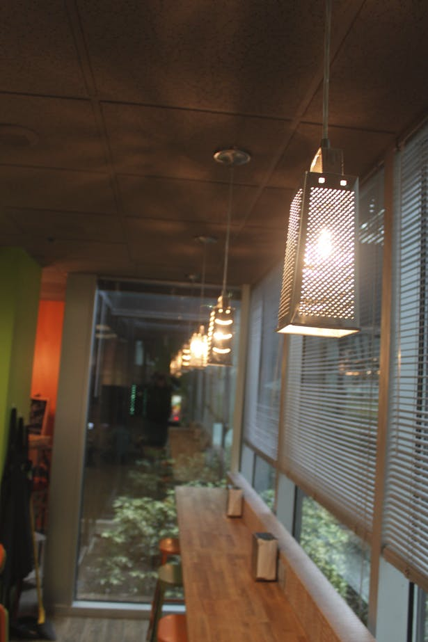 I designed these cheese grater pendant lights for the bar seating.
