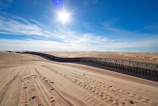 "The U.S.-Mexico border wall ""floats"" across sand dunes in Yuma, Arizona. Photo: Jerry Glaser, 2019/Courtesy of U.S. Customs and Border Protection."