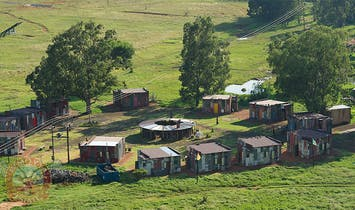 Vacation at a Fake Shanty Town With Luxury Amenities