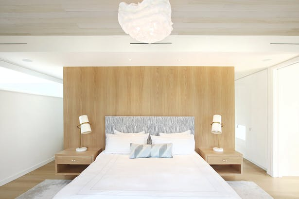 A White Oak Built-In Headboard Wall and Floating Nightstands in the Master Bedroom