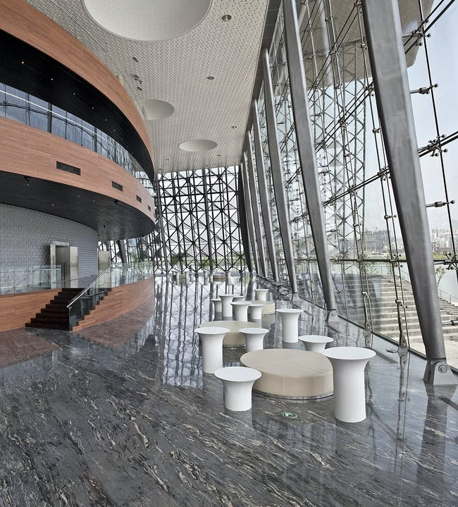 The lake side lobby of the main auditorium. This elevated space is providing great views over the Wuli Lake. The auditorium is accessed via bamboo balconies. The curved auditorium wall is covered with a custom designed glass brick wall. (Photo: Kari Palsila)