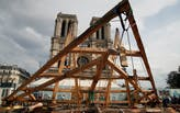 The Catholic University of America is constructing a replica of a Notre Dame roof truss using medieval techniques