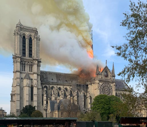 Notre Dame Cathedral's spire engulfed in flames in the evening hours of April 15, 2019. Image: Wandrille de Préville/Wikipedia.