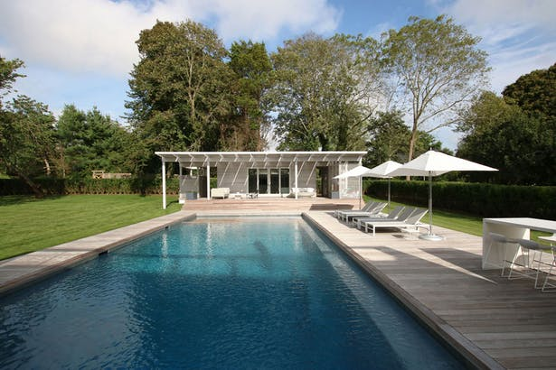 The Large Pool is Wrapped in Ipe Decking with a Small Pool House at its End