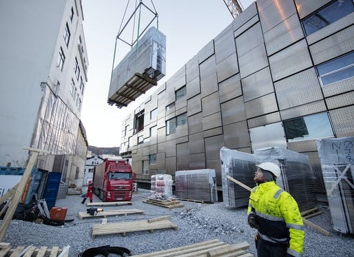 "Facade elements being hoisted into place during construction of the Faculty of Fine Art, Music and Design (""KMD""). Image courtesy of Statsbygg"