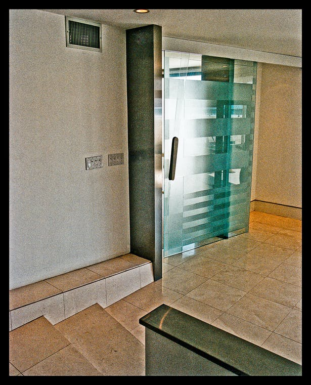 4'x8' suspended blasted glass door entry to master suite. Custom stainless hardware.