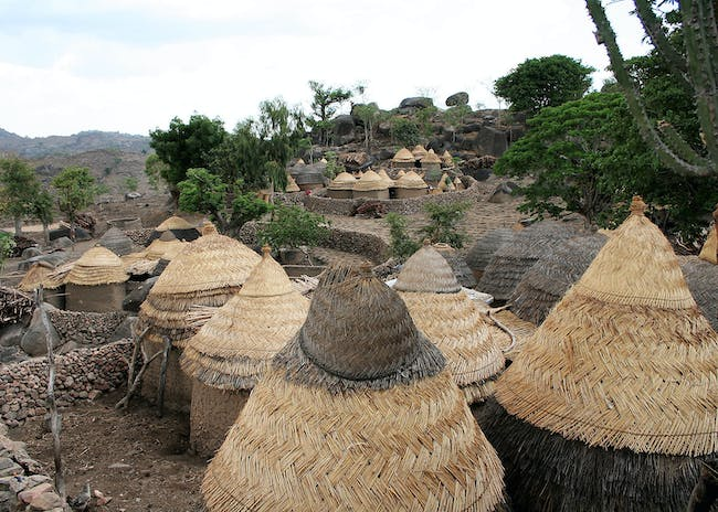 Sukur Cultural Landscape, in Madagali Local Government Area, Nigeria. Traditional Sukur houses are round clay buildings with thatched roofs, 2006. Photo: NCMM/Dipo Alafiatayo