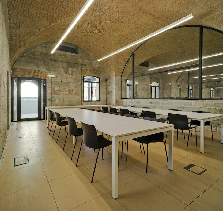 A room designed for management, including stone walls and brick ceilings from the original bunker