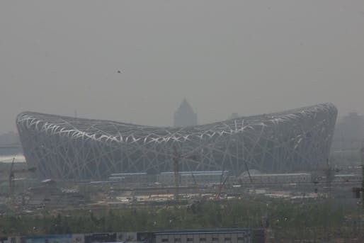The Beijing National Stadium obscured by the city's infamous smog. Image via wikimedia.org.