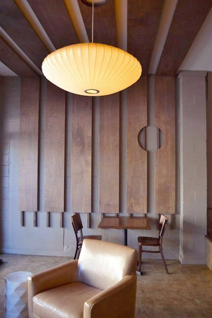Cafe Javasti in Seattle featuring sustainably harvested maple plywood screens. Courtesy of PMDD.