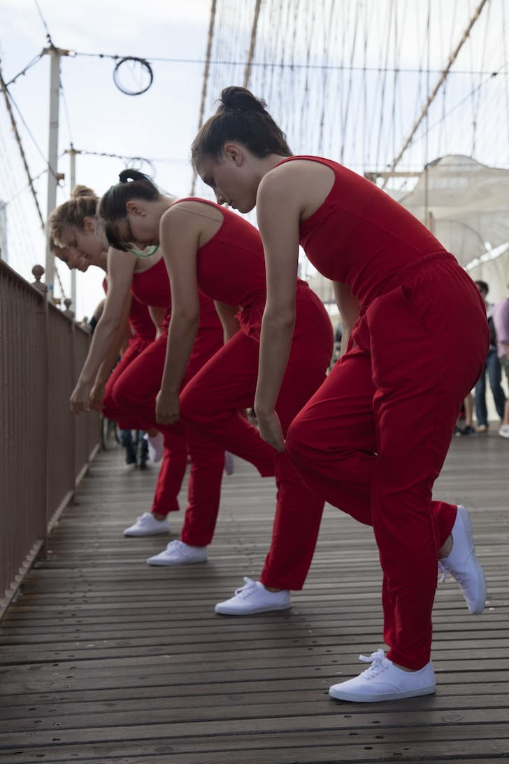 While crossing the Brooklyn Bridge, Rick Moody encountered dancers Kristin Swiat, Giovanna Gamna, Lydia Chrisman, Maya Orchin, Jessica Myers, and Annie Saeugling performing choreography by Jen Harmon for 'When I Left the House it was Still Dark' in New York City in 2013. Photograph by Ayden L.M...