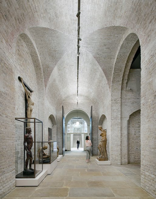 The dramatic exhibition spaces in 'The Vaults' are reminiscent of Chipperfield's careful renovation of the Neues Museum in Berlin. Credit: Simon Menges.