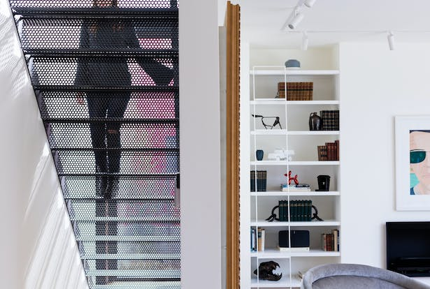 To maintain the addition's sense of transparency, local artisans fabricated a perforated metal staircase that leads directly to the master bedroom suite on the second floor.
