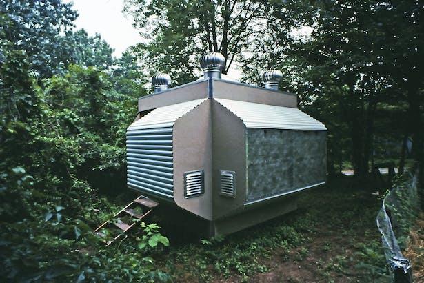 Prefabricated, modular, solar powered backyard office, 1985.