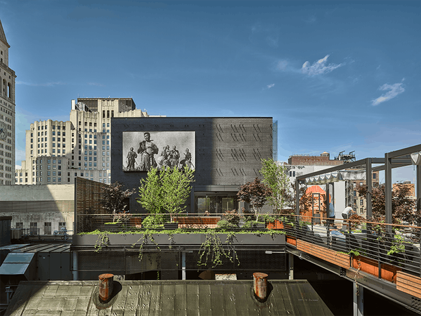 The rooftop includes a movie-theater-like projection screen.