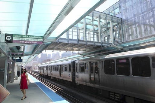 An inbound train passes under the sky bridge at the CTA's new Morgan station on the Near West Side. (Chuck Berman, Chicago Tribune / May 29, 2012)