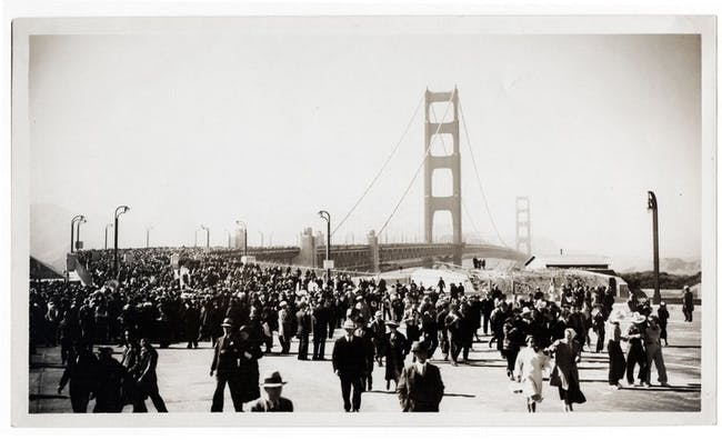 In 1933, the Standard Oil Company sent employee Ted Huggins to photograph the bridge's construction. Huggins visited the site weekly for three years and produced hundreds of photographs, which he offered to news outlets covering the project. Huggins took this picture on the bridge's opening day on May 27, 1937. (Image credit: Ted Huggins/Chevron Corporation)