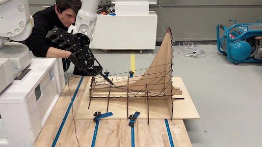 U Penn Professor Ezio Blasetti observing robots fabricating installation components. Image courtesy of the Weitzman School of Design.