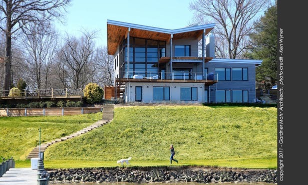 The butterfly roof lends a dramatic flair to the project and highlights the 2-story living space.
