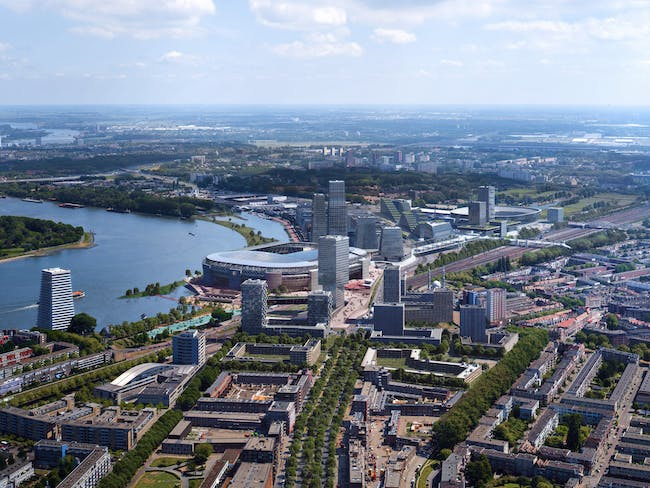 Aerial view of the forthcoming Feyenoord City district. © Image courtesy of OMA and Beauty & The Bit.