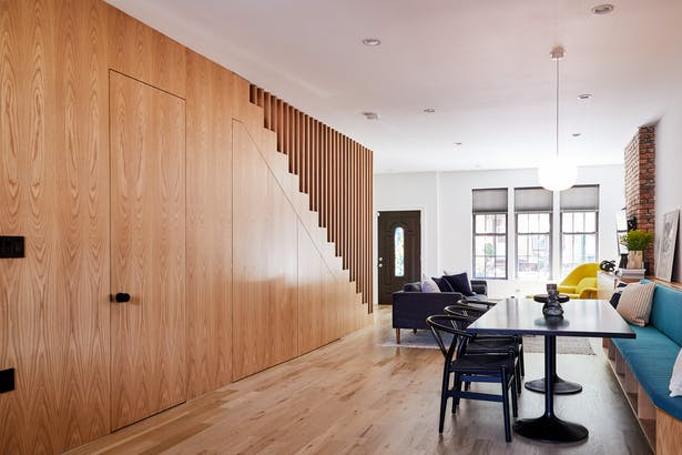 Living Room, Dining Room, and Staircase with Integrated Storage