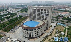 "Despite ban on ""weird architecture"", a building that looks an awful lot like a toilet was built in Henan Province"