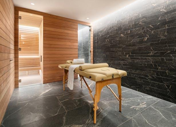 Cellar level spa- custom sauna, steam room and massage area