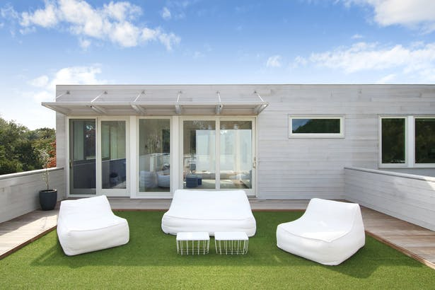 One of Three Roof Decks Off the Second Story, Artificial Turf Tiles Create a Soft for the Kids to Play and Lounge