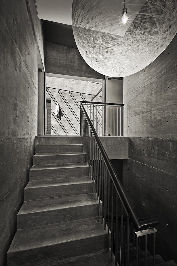 Formed concrete is prevalent throughout the home, the simplicity is ever-obvious within the main stair.