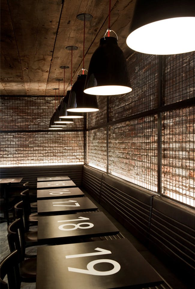 Tartinery Nolita in New York, NY by SOMA Architects (interior design); Caravaggio P2 Black pendants by Lightyears
