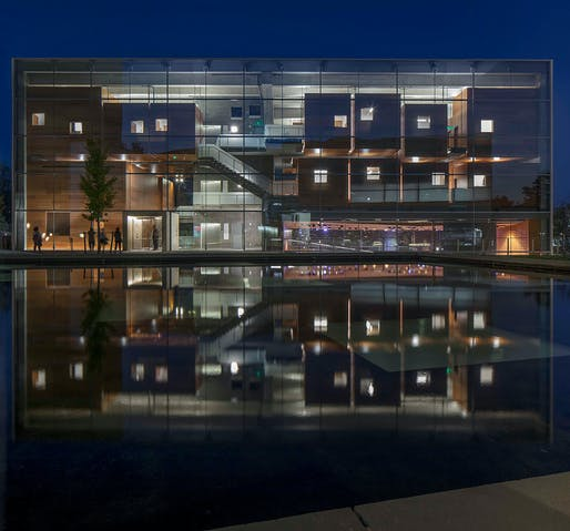 Photograph of the Lewis Center for the Arts, the music building at night as seen across the reflecting pool, Princeton, NJ, 2017. Image: Courtesy of Paul Warchol.