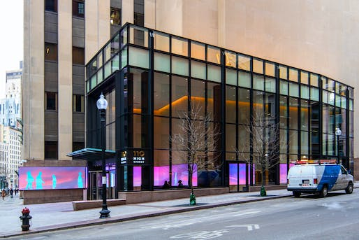 Exterior view showing mirror extruding to street from lobby. © LasSalle Investment Management