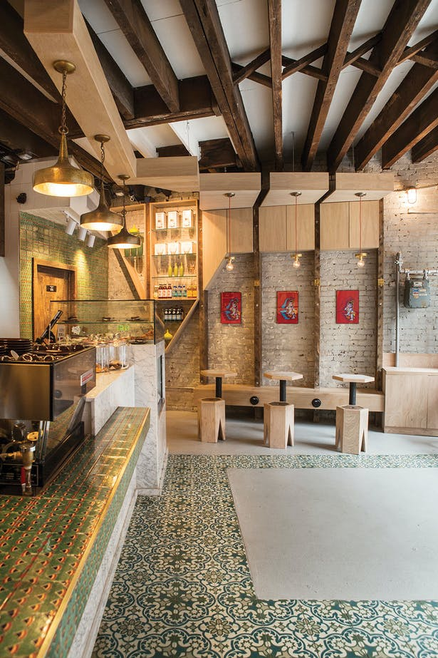 Artisanal tiles are carried throughout the custom designed espresso bar.