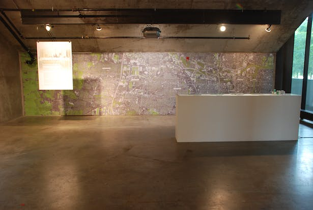 I led the installation of a large scale map (100+ 11'x17' Sheets) across opposite wall