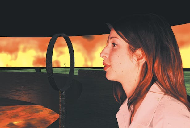 A visitor blows into the interactive ring and the perimeter flames increase in size.