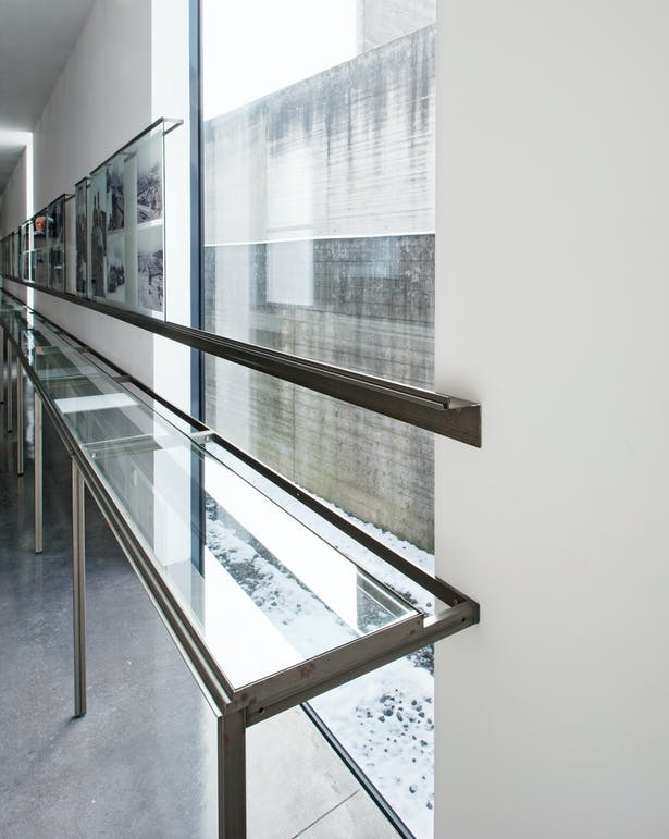 Detail showing metal profiles running in front of window area.