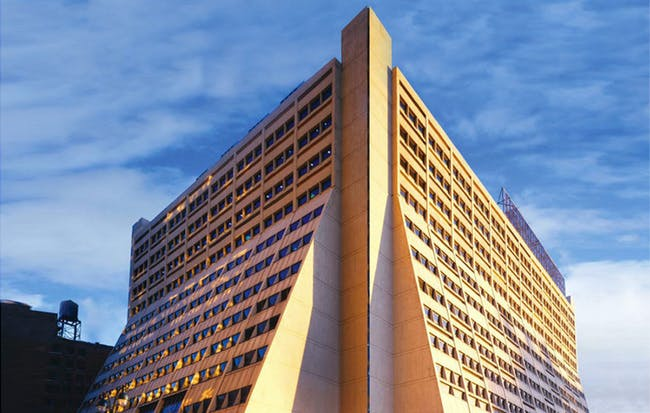'Designed by architecture firm Davis Brody (now Davis Brody Bond) and completed in 1969, 450 West 33rd Street (450W33) is an exemplar of late Brutalist architecture...' Image courtesy of REX.