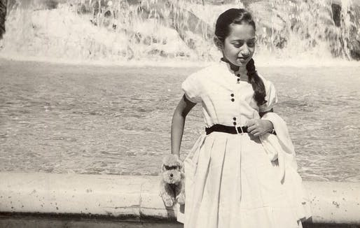 A young Zaha Hadid stands in front of the Trevi fountain in Rome. Image from her family archives, via CNN