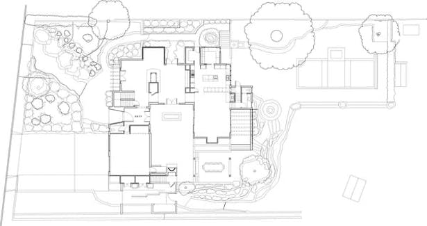 The site plan shows the placement of the U-shaped residence. The topography lines delineate a 14 foot drop in grade from the street to the back yard. The house dances down the slope.