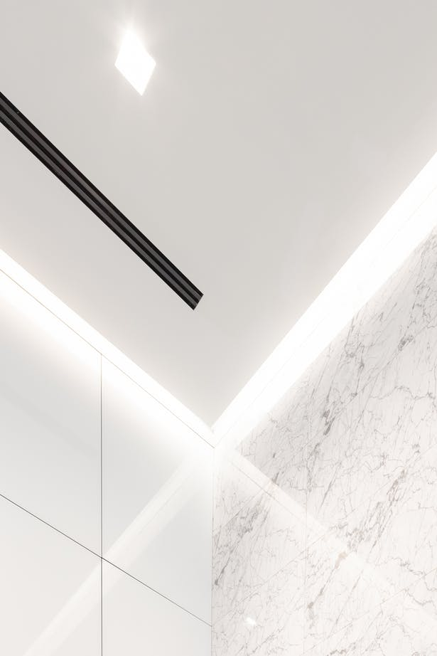 Cove detail where suspended ceiling meets wall finish