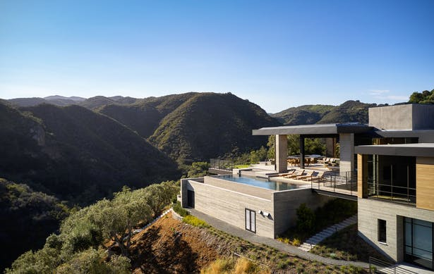 Situated on a promontory jutting into the canyon below, the hillside retreat boasts multiple vistas of the surrounding canyon and the Pacific Ocean beyond. (Roger Davies Photography)